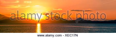 Panoramic shot of scenic sunset over Aegean sea - Stock Photo