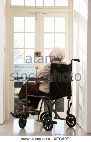 Disabled Senior Woman Sitting In Wheelchair - Stock Photo