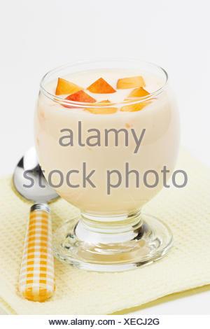 Yogurt with peach - Stock Photo
