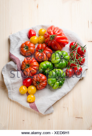 Fresh green and red tomatoes - Stock Photo