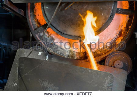 Close up of machinery and molten metal in steel foundry