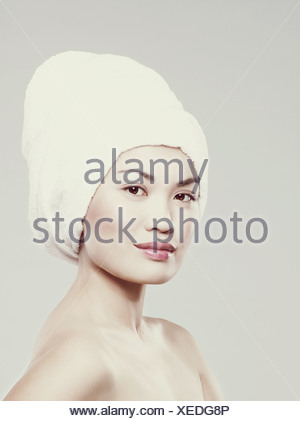 Young woman with hair wrapped in towel - Stock Photo