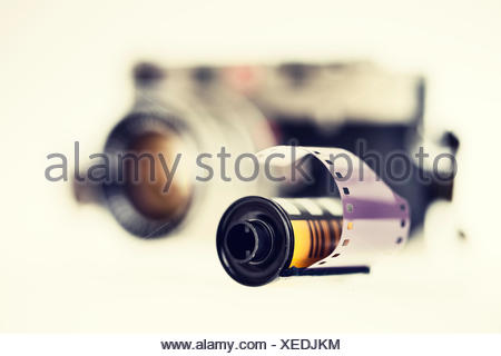 Negative film and old camera in the background, close-up - Stock Photo