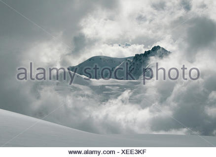 mountains alps hike go hiking ramble switzerland glacier mountain clouds - Stock Photo