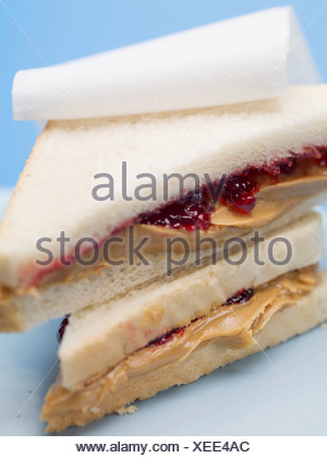 Two peanut butter and jelly sandwiches - - Stock Photo