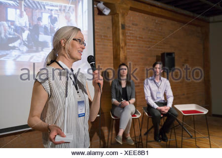 Speaker presenting with wind turbine model - Stock Photo