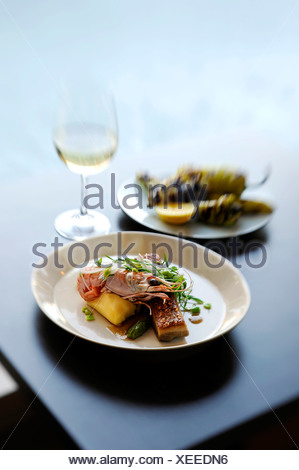 Still life with prawn, potato and micro greens - Stock Photo