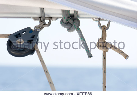 Close-up of sail ship rigging against the blurred sea and sky - Stock Photo