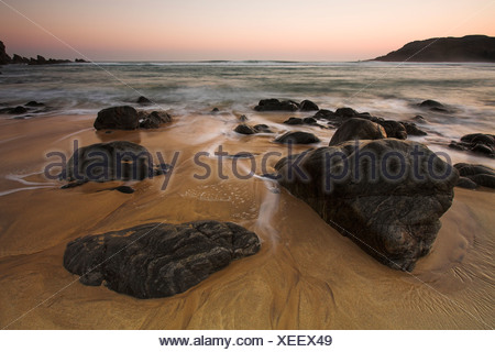 Rocks and sunset at Dhail Mor beach, Lewis, Outer Hebrides - Stock Photo
