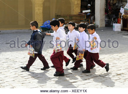 School children wearing school uniforms, Doha, Qatar, Arabian Peninsula, Persian Gulf, Middle East, Asia - Stock Photo