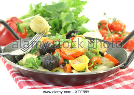 fresh pasta pan with bell pepper - Stock Photo