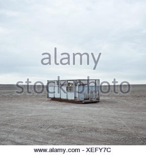 USA, Wyoming, Garbage container on prairie - Stock Photo