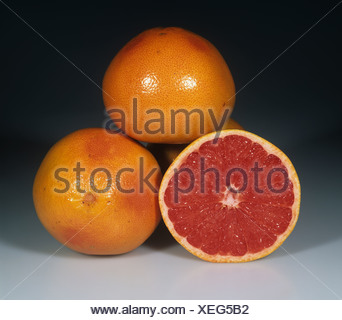 Whole and section grapefruit fruit variety Flame - Stock Photo