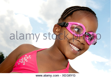 Girl wearing goggles and bikini outdoors, Johannesburg, Gauteng Province, South Africa - Stock Photo