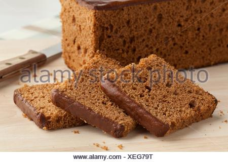 Traditional dutch breakfast cake cut into slices. - Stock Photo