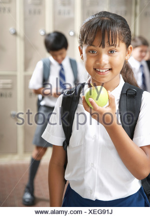 Students in the school hallway - Stock Photo