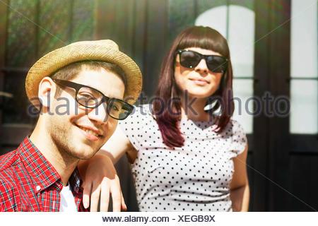 Young couple taking a break in sunlight,  Osijek, Croatia - Stock Photo