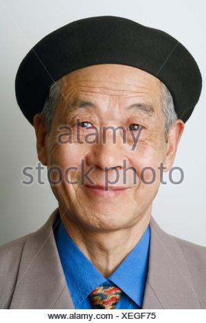 Close-up of a senior man smiling - Stock Photo