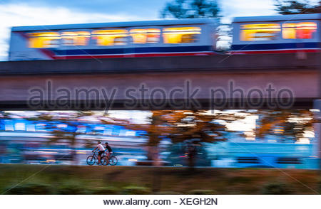 Bicyclists and Skytrain, Vancouver, British Columbia, Canada - Stock Photo