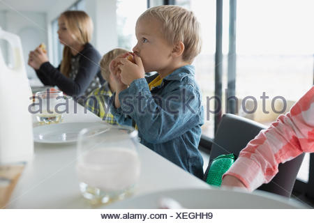 Family eating at kitchen island - Stock Photo