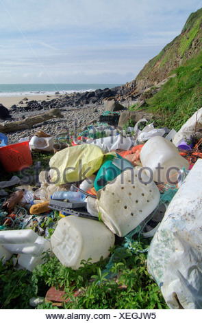 Plastic litter washed up by sea - Stock Photo