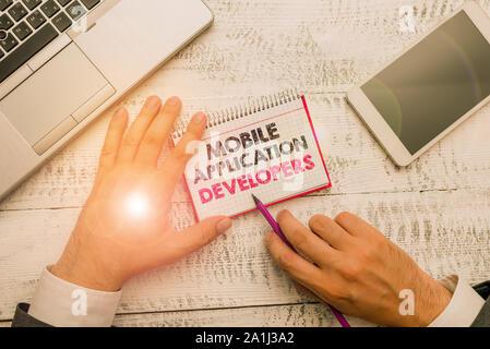 Wort schreiben Text Entwickler mobiler Anwendungen. Business photo Präsentation erstellen Software für Geräte wie App Store - Stockfoto