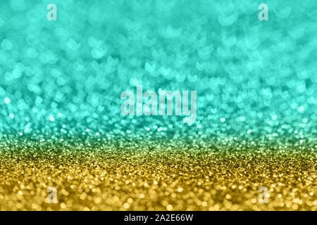 Abstrakte Komposition. Turqupose und golden Glitter hellen Hintergrund mit schönen Bokeh, selektiver Fokus, geringe Tiefenschärfe