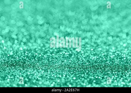 Abstrakte Komposition. Trendiges türkis mint Glitter hellen Hintergrund mit schönen Bokeh, selektiver Fokus, geringe Tiefenschärfe