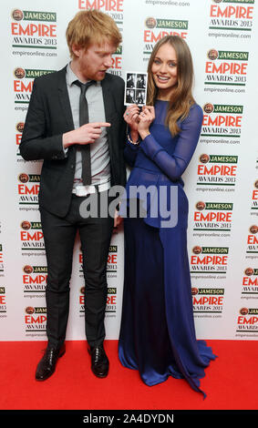 Foto muss Gutgeschrieben © Kate Grün/Alpha Presse 077037 24/03/2013 Domnhall Gleeson und Laura Schellfisch in der Jameson Empire Film Awards 2013 im Grosvenor Hotel in London - Stockfoto