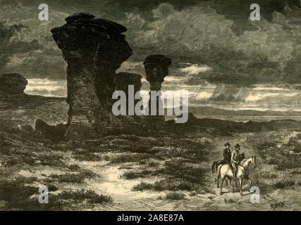 'Dial Rock, Rot Buttes, Laramie Plains', 1874. Felsformation in Wyoming, USA. ' Die fernen Roten Buttes sind die meisten Hinweis - würdig und malerischsten Dieser; zusammen wie riesige Festungen gruppiert, mit fantastischen Türmen und Mauern, sie heben ausgefranste Kanten über die Prärie, einsam, sonderbar, und stark. Unter den einzigartigen Formen ihre Massen von Stein übernehmen, die seltsam geformte und Säule - wie das Freizeichen Felsen Turm - vier Säulen getragen und vernarbte Sandstein, wie die unterstützt von einigen ruiniert cromlech von Riesen erbaut. Über sie, und durch die ganze Region... das Land ist eine Öde, - Stockfoto