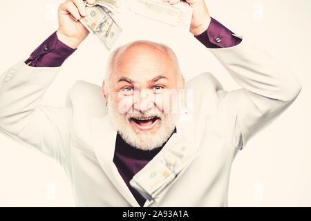 Geschäftskonzept. Reife bärtige Mann mit Dollar Banknoten. Reiche reifer Mann hat viel Geld. den geschäftlichen Erfolg. Reichtum. Ruhestand. Happy Lotterie w - Stockfoto