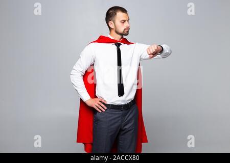 Young Business Mann super hero Blick auf Uhr auf weißem Hintergrund - Stockfoto