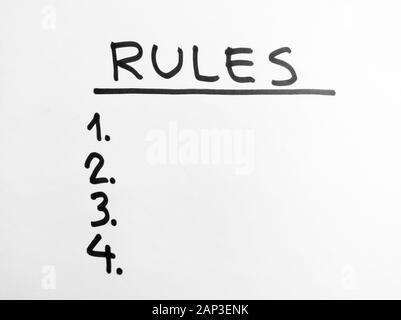 Hand Worte - Regeln - mit schwarzem Marker auf weißem Papier - Stockfoto