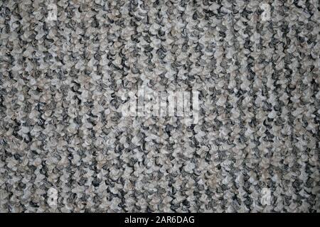 Teppich für den Boden im Büro. Grauer synthetischer Teppichhintergrund. Filzteppich Oberansicht Textur. - Stockfoto