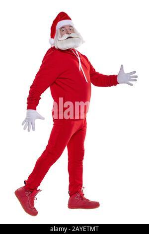 Porträt eines Weihnachtsmannes in rotem Sportwagen in vollem Wachstum - Stockfoto