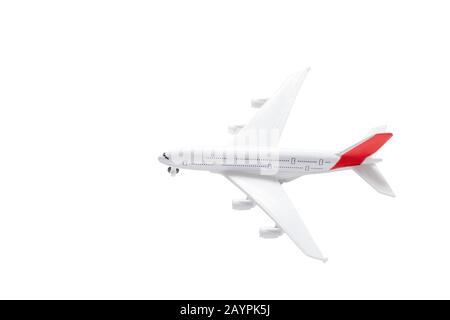 Isoliertes Spielzeugmodell eines Flugzeugs. Reise- und Lufttransportkonzept - Stockfoto