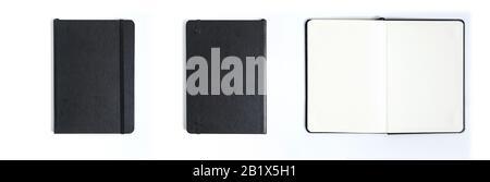 Notebook schwarz auf weißem Hintergrund mit Freistellungspfad - Stockfoto