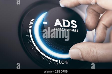 Finger drehen eines Effektivitätsknopfes der Werbeanzeigen in der höchsten Position. Effektives Konzept für Werbekampagnen. Zusammengesetztes Bild zwischen einer Handfotografie a - Stockfoto