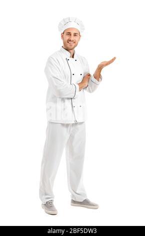 Stattliche männliche Koch zeigt etwas auf weißem Hintergrund - Stockfoto
