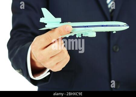 Geschäftsmann hält Flugzeugmodell in der Hand, Nahaufnahme - Stockfoto