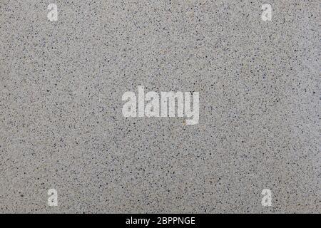 Nahaufnahme kleine winzige Stein Kieselstein in Beton Boden Textur Hintergrund - Stockfoto