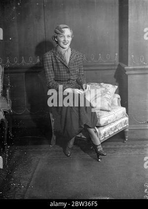 """Charlie Chaplin ' s führende Dame in London . Miss Virginia Cherrill, die die Rolle des blinden Mädchens von """"City Lights"""" gegenüber Charlie Chaplin spielte, ist in London. Dies ist ihr erster Besuch in England. 20. November 1933 - Stockfoto"""