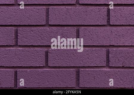 Nahaufnahme von gemalten lila Backstein Wand Textur Hintergrund.