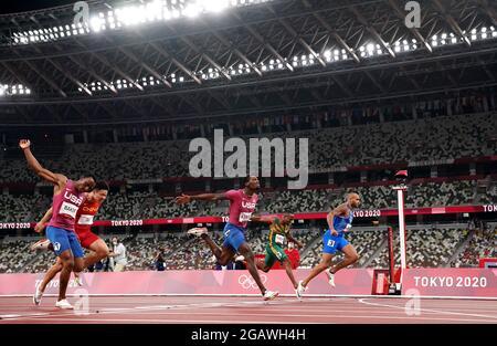 Der Italiener Lamont Jacobs (rechts) gewinnt am neunten Tag der Olympischen Spiele in Tokio 2020 in Japan die 100 Meter der Männer im Olympiastadion. Bilddatum: Sonntag, 1. August 2021.