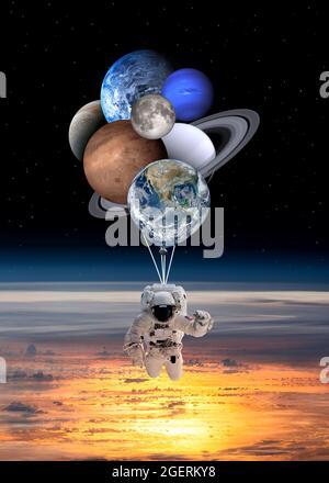 Astronaut-Raumfahrer mit planetenförmigen Ballons im Sonnensystem. Elemente dieses Bildes, die von der NASA eingerichtet wurden.