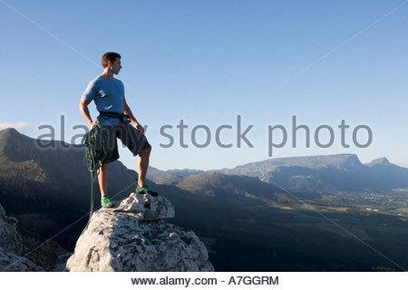 Ein Kletterer an der Spitze - Stockfoto