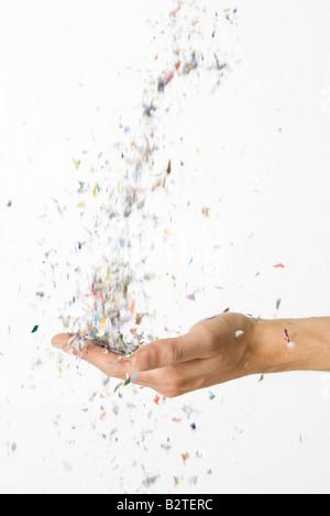 Hand fangen fallenden Konfetti - Stockfoto