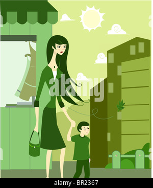 Eine Frau hielt ihre hand Söhne, als sie auf der Straße Fuß - Stockfoto