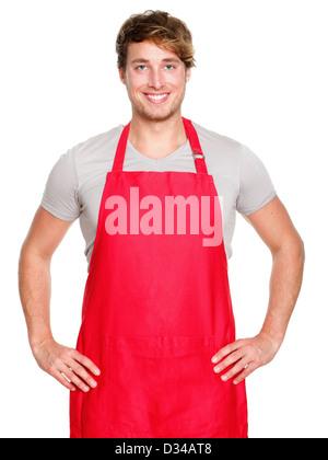 Porträt des Lächelns kaukasischen männlichen Jungunternehmer oder Verkäuferin in rote Schürze isoliert auf weißem - Stockfoto
