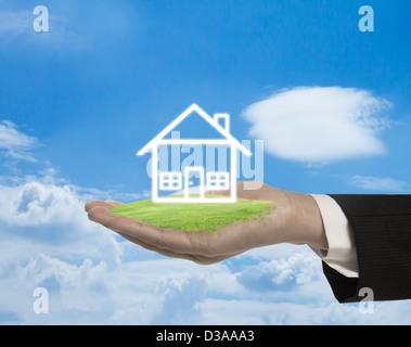 Abstrakte Haus auf der Hand. - Stockfoto